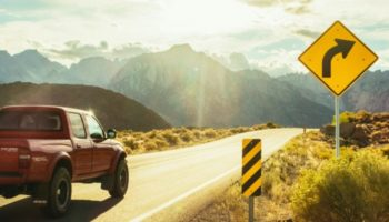 Must-a-municipality-post-warning-signs-road-curve-accident-injury-washington-law-center
